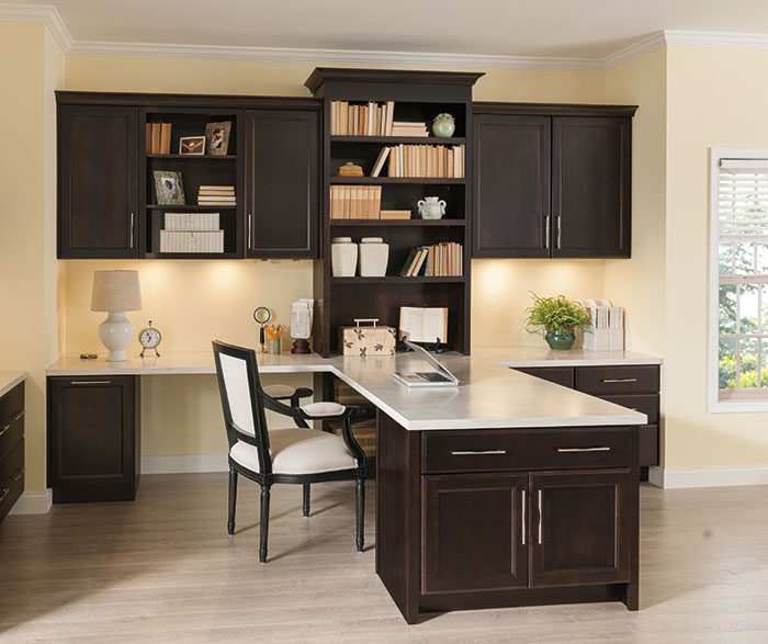 Chocolate cabinets in a home office by Kemper Cabinetry