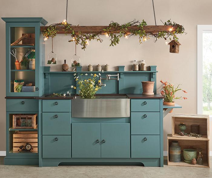 Blue garden storage cabinets in Trystan door style